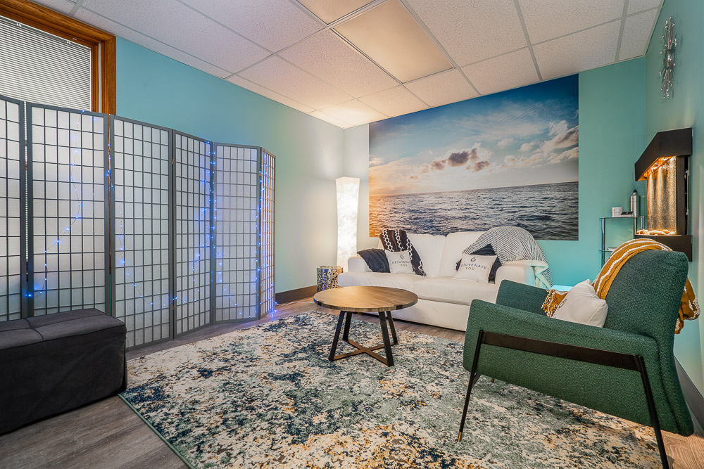 A calming waiting lounge space at Rejuvenate You.